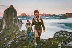 Couple travelers holding hands hiking together in Norway stock images