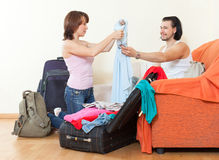 Couple of travelers with luggage in home going on holiday Stock Images