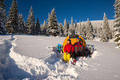 Couple of travelers relax at alpine meadow Stock Images