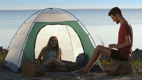 Couple of travelers relaxing at seaside in summer stock footage