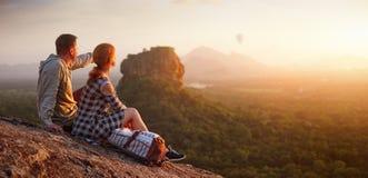 Free Couple Travelers Watch Beautiful Sunset Near Famous Rocky Plateau Lion Peak, Sigiriya. Sri Lanka Royalty Free Stock Photo - 172368115
