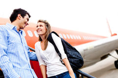 Couple traveling by airplane Royalty Free Stock Image