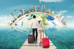 Couple traveling around the world Royalty Free Stock Photos