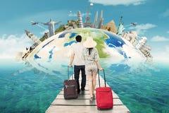Couple traveling around the world Royalty Free Stock Photos