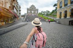 Asian hipster traveler looking to Ruins of St. Paul`s royalty free stock photo