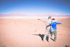 Couple traveling on the Bolivian Andes, toned image Royalty Free Stock Photo