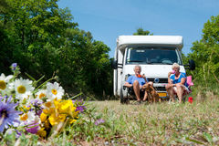 Couple is traveling by camping car. Elderly couple with their dog is travel by camping car royalty free stock images