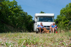 Couple is traveling by camping car royalty free stock photography
