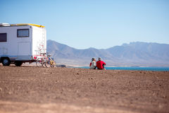 Couple traveling by camping trailer Royalty Free Stock Image