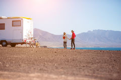 Couple traveling by camping trailer Stock Photos