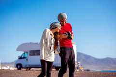 Couple traveling by camping trailer Royalty Free Stock Photography