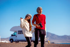 Couple traveling by camping trailer Royalty Free Stock Images