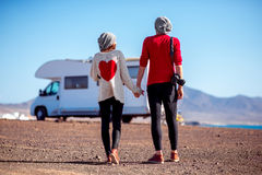 Couple traveling by camping trailer Royalty Free Stock Photo