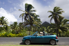 Couple traveling by convertible car in a Pacific Island. Travel - happy couple, young Mediterranean men and Caucasian woman, smiling joyfully on sunny summer day stock photos
