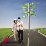 Couple traveling on the road Royalty Free Stock Images