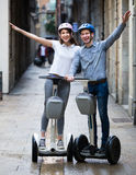 Couple traveling by segways Stock Photography
