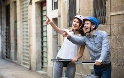 Couple traveling by segways Stock Image