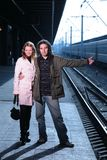 Couple traveling by trains royalty free stock images