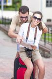 Couple Traveling with Trolley Suitcase Outdoors. Royalty Free Stock Photo