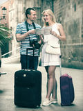 Couple travellers holding map stock images