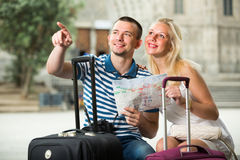 Couple travellers holding map royalty free stock photo