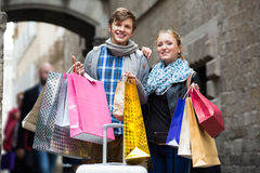 Couple of travellers with shopping bags Stock Image