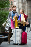 Couple of travellers with shopping bags Royalty Free Stock Images