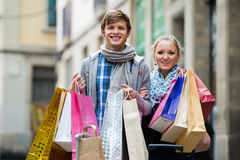 Couple of travellers with shopping bags Stock Photos