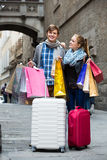 Couple of travellers with shopping bags Royalty Free Stock Photography
