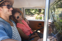 Couple travelling in campervan. Smiling couple travelling in campervan Royalty Free Stock Photos