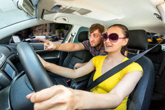 Couple travelling by car in the mountains Stock Photography