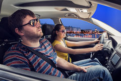 Couple travelling by car Royalty Free Stock Images