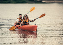 Couple travelling by kayak Royalty Free Stock Photography