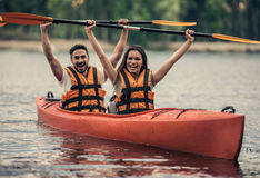 Couple travelling by kayak Stock Photos