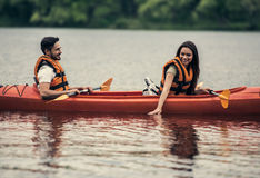 Couple travelling by kayak Stock Photo