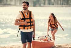 Couple travelling by kayak Stock Images