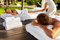 Couple Treatment At Spa. People Enjoying Relax Massage Outdoors Royalty Free Stock Photos