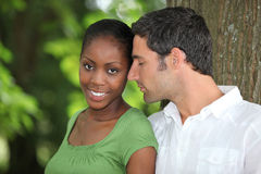 Couple by a tree Royalty Free Stock Image