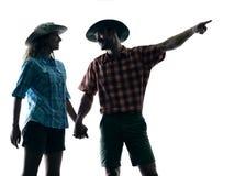 Couple trekker trekking pointing nature silhouette Royalty Free Stock Photos