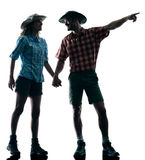 Couple trekker trekking pointing nature silhouette stock images