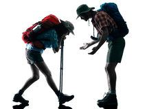 Couple trekker trekking tired silhouette Stock Photo