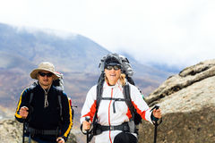 Couple trekkers hiking in mountains Royalty Free Stock Photography