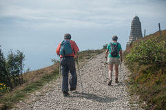 Couple of trekkers walking at the top with backpack Royalty Free Stock Image