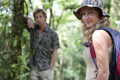 Couple Trekking. Man and women in a forest expedition royalty free stock photography