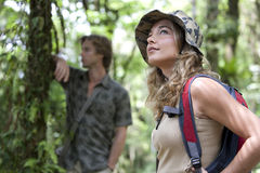 Couple Trekking. Man and women in a forest expedition stock image