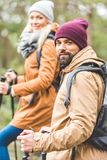 Couple trekking in autumn forest Stock Photography