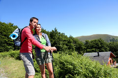 Couple on a trekking day in mountains Royalty Free Stock Photos