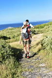 Couple on a trekking day sightseeing beautiful islands stock images
