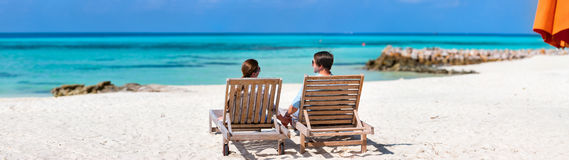 Couple at tropical beach Royalty Free Stock Images