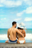 Couple on a tropical beach at Bali Stock Photo